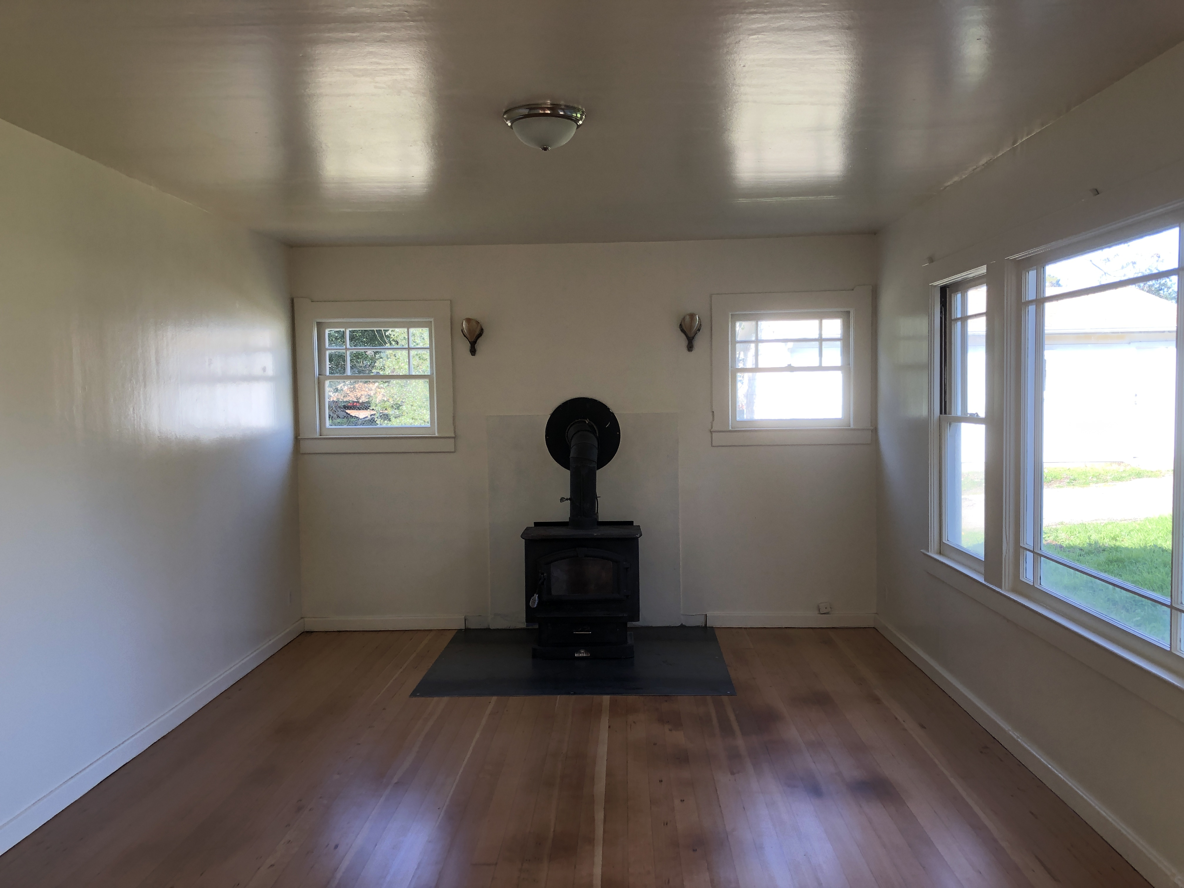 Living Room with good, working wood stove