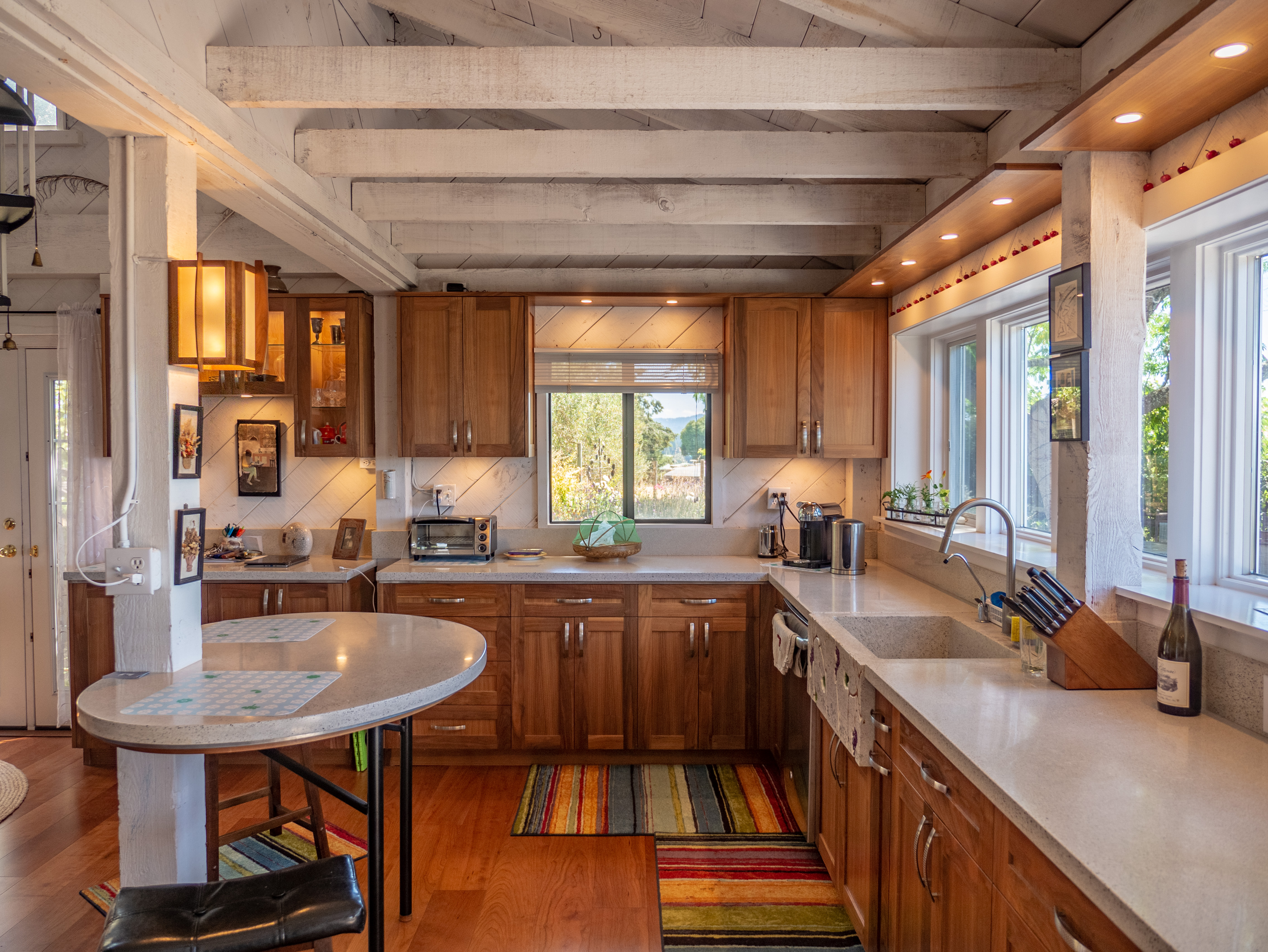 Dream Kitchen - custom cabinets, concrete counter tops, large farm sink, windows featuring that valley view and a lovely flower garden