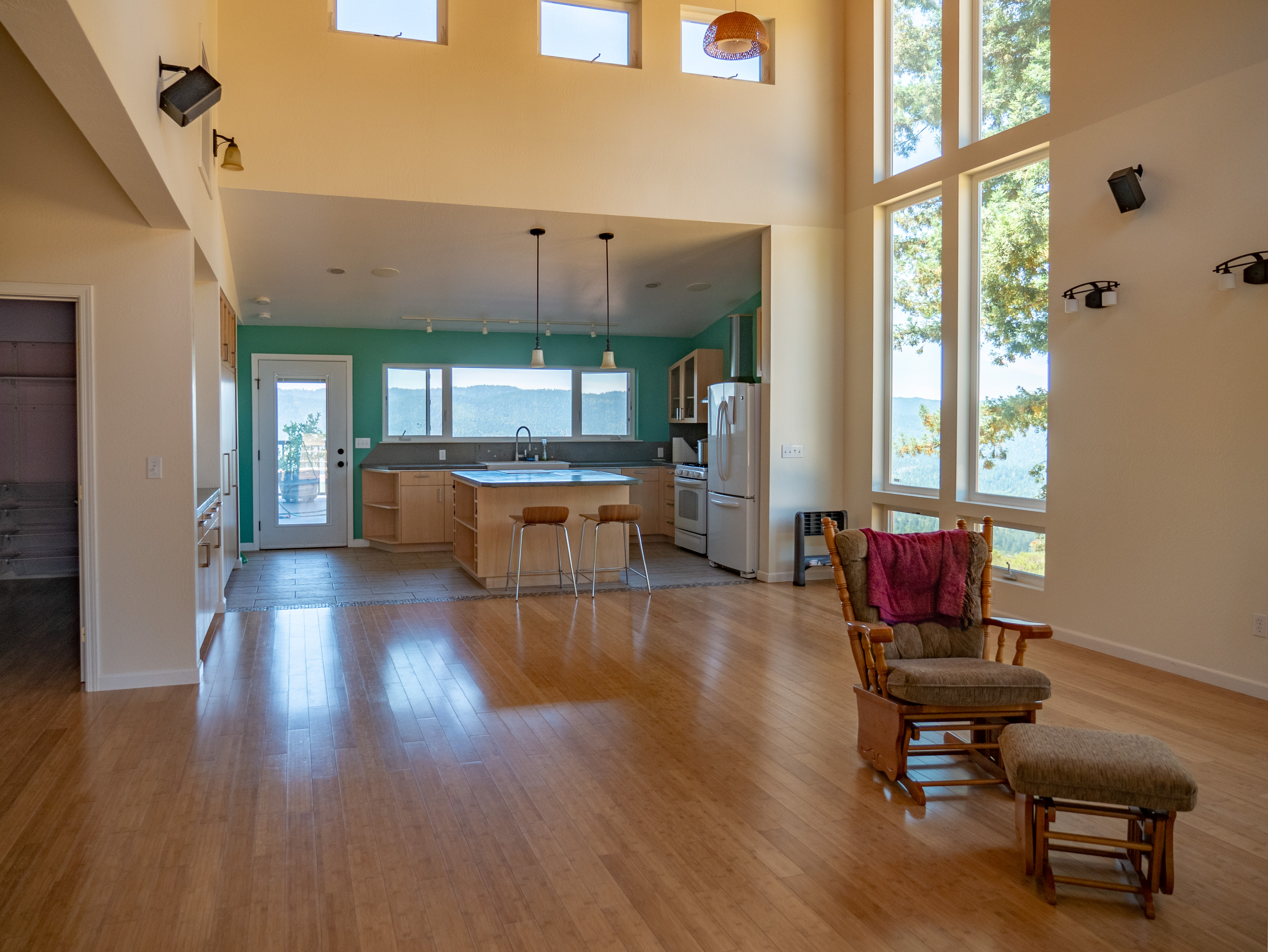 The great room offers those panoramic views from every window.  the door leads to deck.  The home faces south.